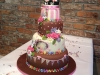 Colourful chocolate wedding cake with topper, bunting & marzipan flowers