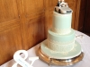 Tall, 2 tier wedding cake with cake topper & edible lace.