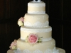 4 tier Wedding cake ~ with rich fruit cake, lemon & vanilla flavoured sponges. Decorated with fresh flowers & edible lace.